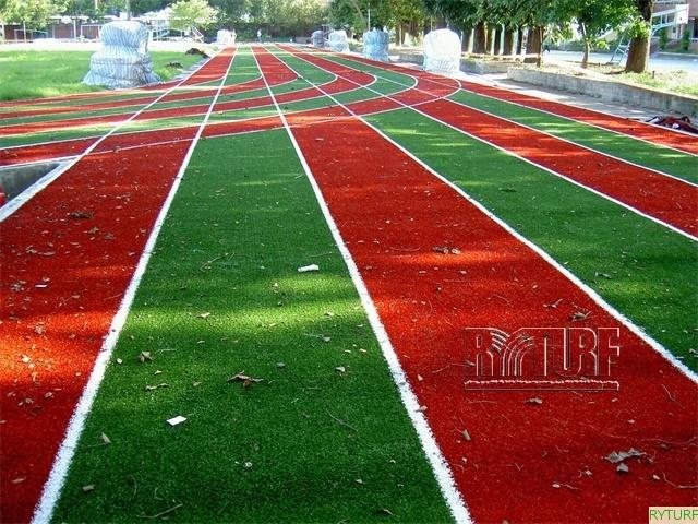 Artificial turf running tracks